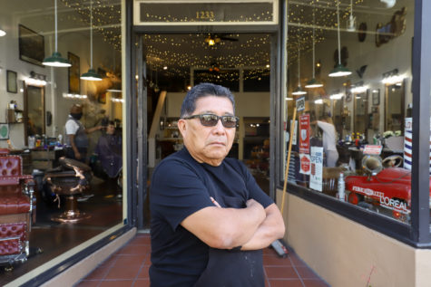 "After working in a strict corporate environment for so many years, Domingo Lopez enjoys working outdoors on his own time, mixed in with the crowds and seeing old clients. ""I wouldn't trade it,"" he said, and also adding that when he sees his old clients he's ""excited to see them again."""