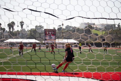 Analea Pule, center, launches the ball across the field with her goalie kick during the first home game of the fall 2021 season on Sept. 7 in La Playa Stadium at Santa Barbara City College in Calif. The Vaqueros defeated the Taft College Cougars 6-1.
