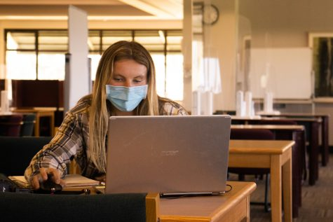 Kirsten Milliron catches up on homework in the Luria Library during its official reopening on Sept. 9, at City College in Santa Barbara, Calif. Milliron said the quiet and calm atmosphere of a library is exactly what she's needed in order to get her work done properly.