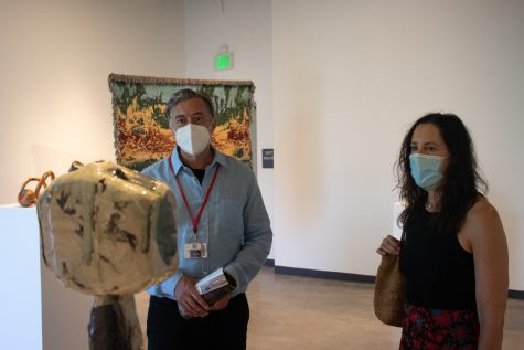 John Connelly shows his associate Kim Brown around City Colleges new exhibit, Planet Earth, on Sept. 10 in the Atkinson Gallery at City College in Santa Barbara, Calif. The recurring theme of the exhibit is the space we occupy on the land and sea.