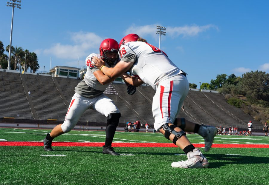 Howard Wood, right, and Deandre Chandler, left, clash during defensive practice on Sept. 1, 2021 at La Playa Stadium in Santa Barbara, Calif. This is their first year at Santa Barbara City College.