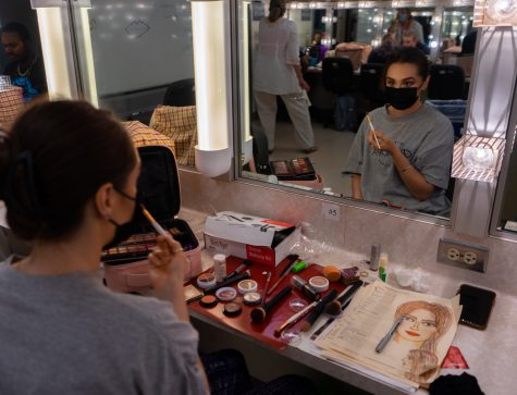 Stephanie Brown applies make-up around her eyes during Theatrical Make-up class on Sept. 8, 2021 in DM130 at Santa Barbara City College in Calif. The students draw out the final design on paper first, then apply it to themselves.