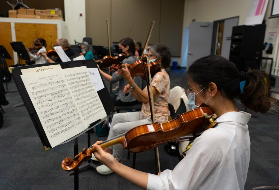 Salome Huang and the rest of the violin section rehearse the first movement of Dvorak's New World Symphony for the Symphony Orchestra class on Sept. 7, 2021 in DM105 at Santa Barbara City College in Calif. Huang plays second violin for the City College Orchestra.