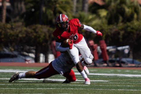 Running Back Jerry Martin dodges an LA Pierce College tackler on Saturday, Oct. 16 at City Colleges La Playa stadium in Santa Barbara, Calif. City College beat LA Pierce 60-6.