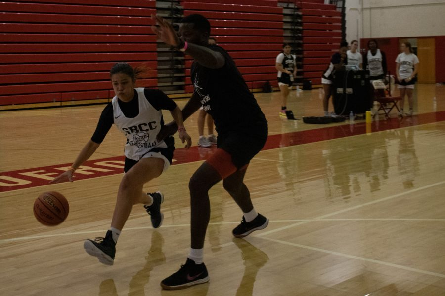 The women's basketball team run new plays with assistant coach JoeRandle Toliver during practice on Oct. 7 at City College's Sports Pavilion in Santa Barbara, Calif. Toliver would stop the game in the middle of a play to correct the team and show them how to improve their technique.