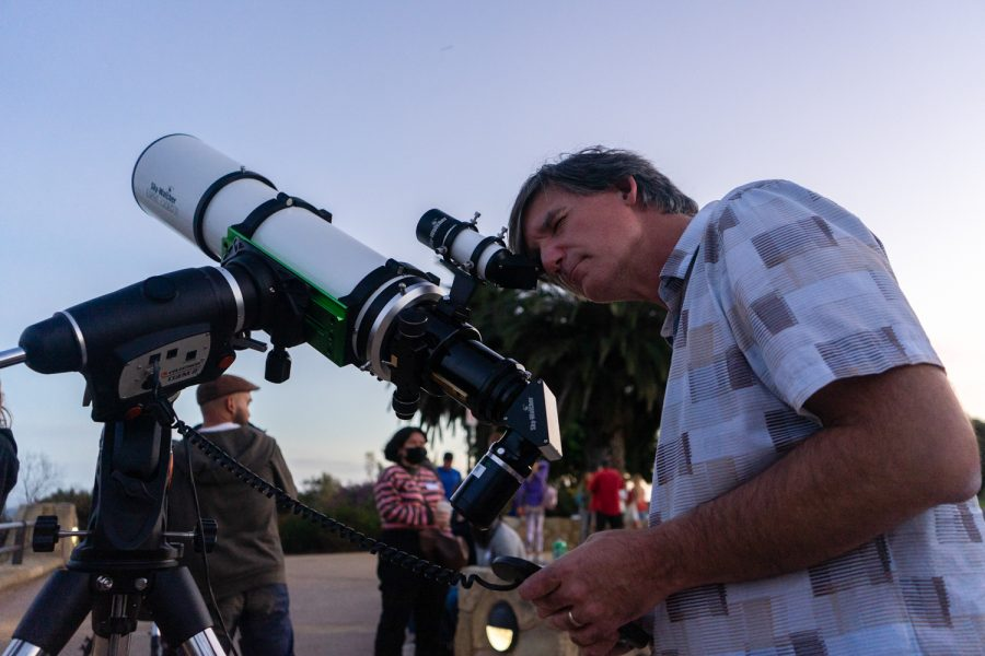 Astronomy instructor Sean Kelly aligns a telescope towards Saturn during an astronomy club meeting on Oct. 9 at City College in Santa Barbara, Calif. This was the club's first in-person event in over 19 months.
