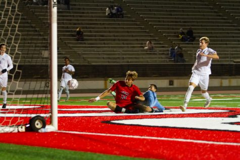 Number 14, Bart Muns, slides the ball past the goalie for City College's second goal of the night on Oct. 19 at La Playa Stadium at City College in Santa Barbara, Calif. Their current record is (8-3-2) for the fall 2021 season.