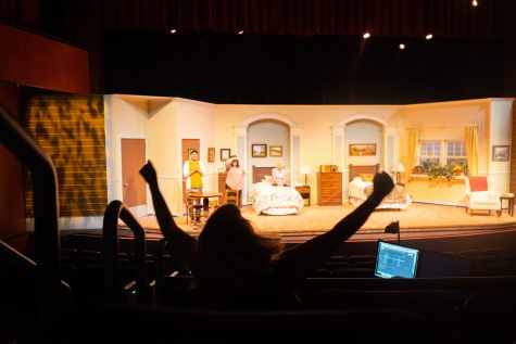 """Katie Laris, theatre arts department co-chair and director of """"Ripcord"""", demonstrates how she'd like one of the actors to raise his arms for the ending of a scene on Oct. 6 in the Garvin Theatre at City College in Santa Barbara, Calif. The crew had to work on cutting the lights when the actors arms went up."""