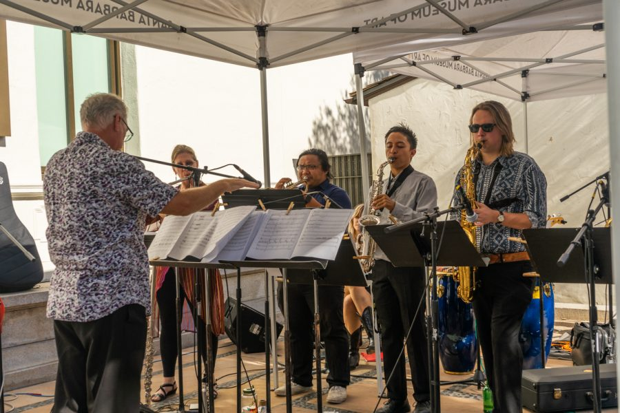 Edward Smith, City College New World Jazz Ensemble Director, conducts the band through their final composition of the day on Oct. 9 on the terrace of the Santa Barbara Museum of Art. Each student wrote their own composition based on pieces from the museum.